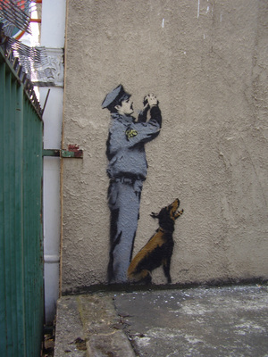 Security_Guard_and_Dog_detail_of_One_Nation_Under_CCTV.jpg