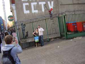 Tourists_posing_by_One_Nation_Under_CCTV.jpg